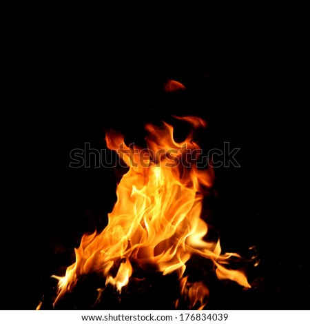 Red fire and flame with a black background - stock photo
