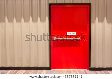 Red fire exit door in an office building. - stock photo