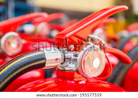 Red fire extinguishers available in fire emergencies. - stock photo