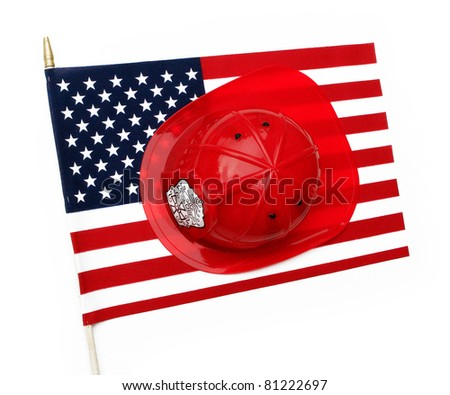 Red fire fighter helmet hat on US flag isolated on a white background - stock photo