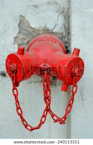 Red Fire Hydrant in the old wall. - stock photo
