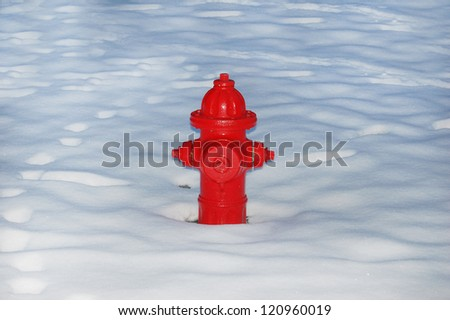 Red Fire Hydrant in the Snow - stock photo