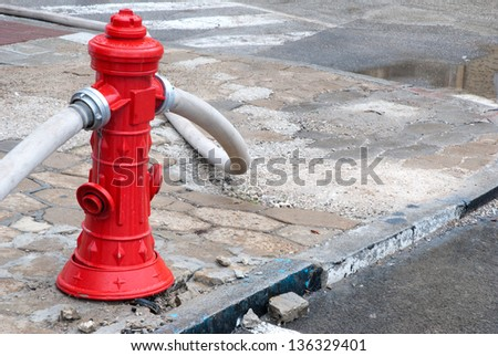 Red fire hydrant in use