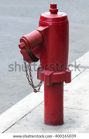 red fire hydrant on a city street - stock photo