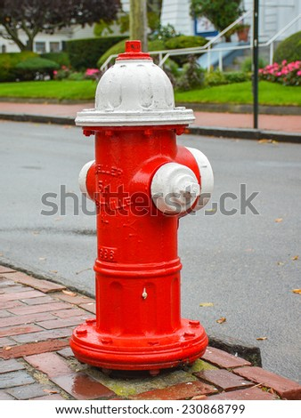 Red Fire Hydrant With White Top - stock photo