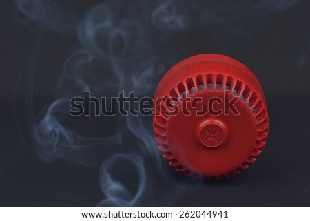 red fire siren with smoke  - stock photo