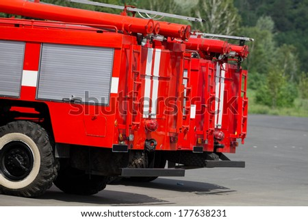 Red fire trucks in parking