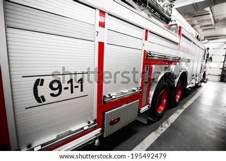 Red Firetruck Details of the Side and of the 911 telephone Sign - stock photo