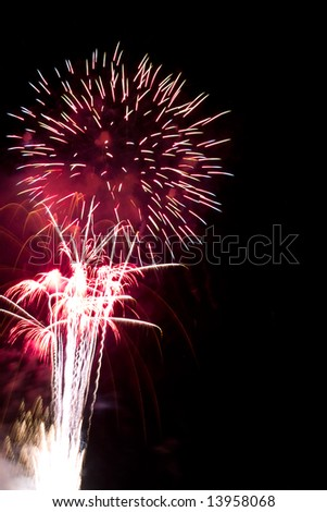 Red firework over the black sky