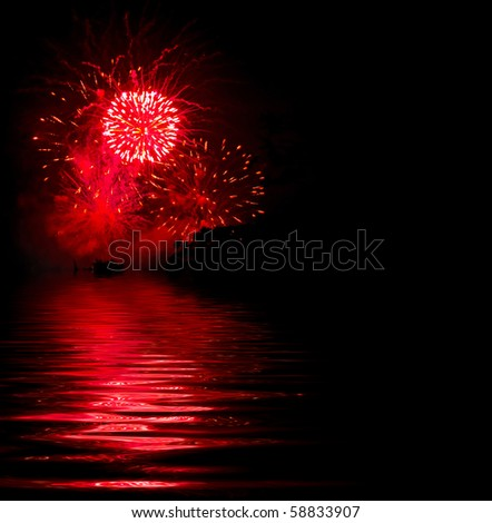 Red fireworks explosion on a black background - stock photo