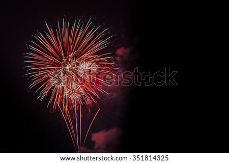 Red fireworks, Fireworks explode, fireworks background, texture. Beautiful fireworks, light show in black background, fireworks background, popular in Malta, New Year, Independence day - stock photo