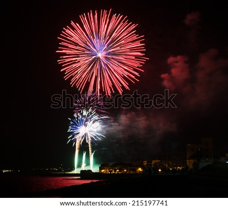 red fireworks in Alghero on a summer night