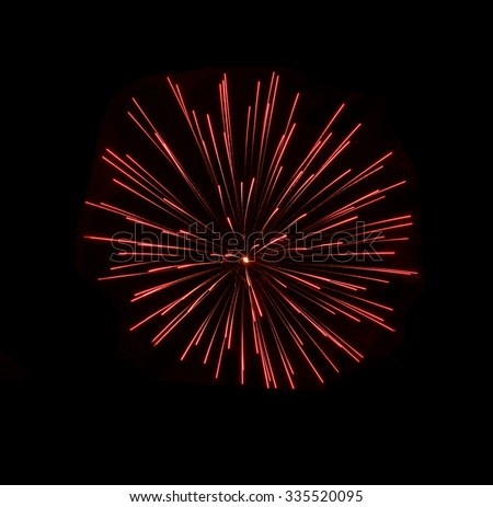 Red fireworks, light show in black background, popular in Malta, New Year, Independence day. Fireworks background - stock photo