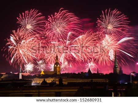 Red fireworks over Riga, Latvia during Riga City Festival 2013 - stock photo