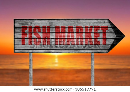 Red Fish Market wooden sign with on a beach background - stock photo