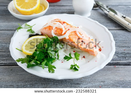 Red fish on a plate with lemon and parsley, seafood