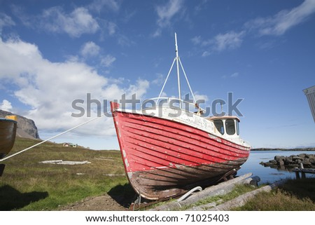 Red Fishing boat in Iceland - stock photo