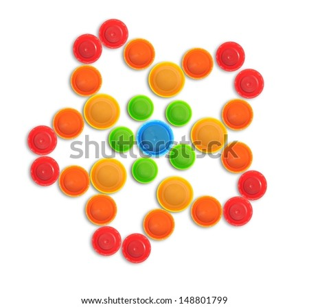 Red five petal flower made of bottle cap - stock photo