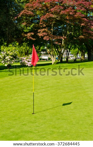 Red flag at the beautiful  golf course.  Vancouver, Canada.