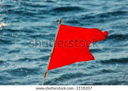 Red Flag - Huricane - stock photo
