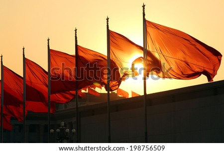 red flags at sunrise - stock photo
