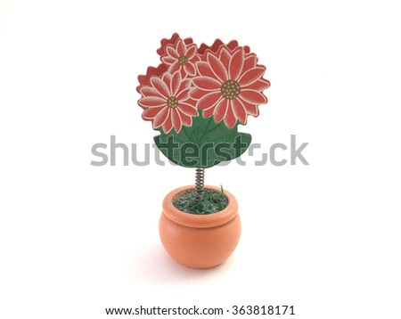 Red flower clip isolated on small brown flower pot in horizontal  - stock photo