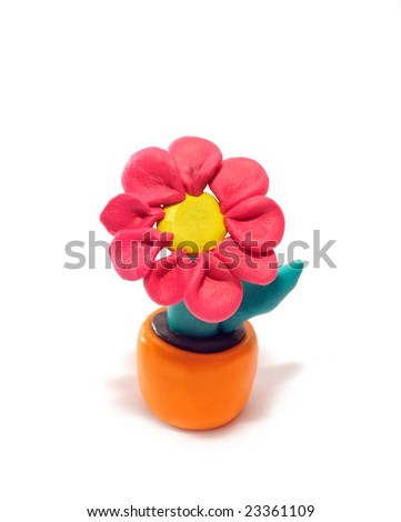 Red flower in a pot. It is made of plasticine. - stock photo