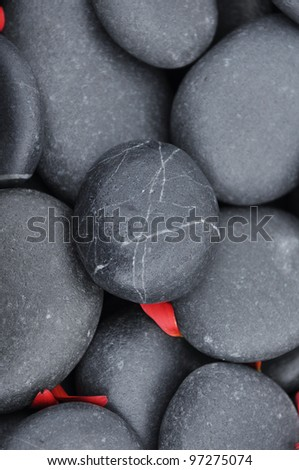 Red flower petals on pebbles background