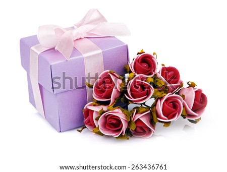 red flowers and purple gift box with pink ribbon on white background - stock photo