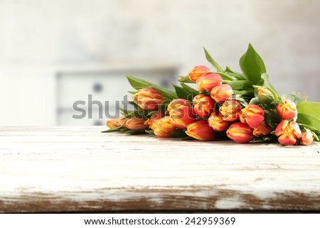 red flowers of tulip and desk of white  - stock photo