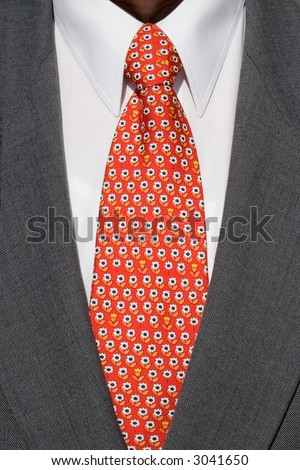 red flowery tie and grey suit - stock photo