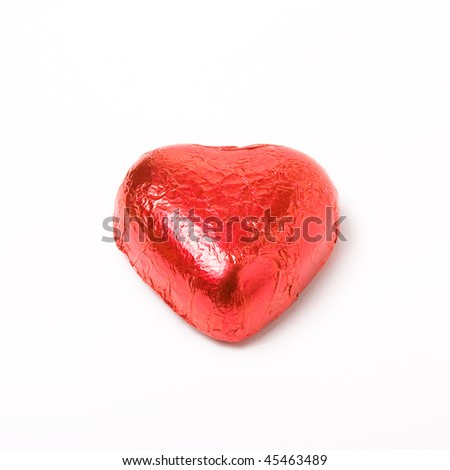 Red foil wrapped chocolate hearts for valentine's day - stock photo