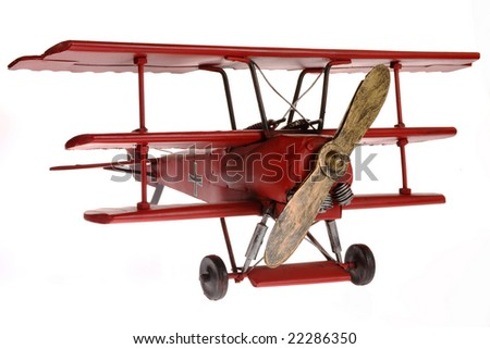 Red Fokker triplane isolated on white background - stock photo