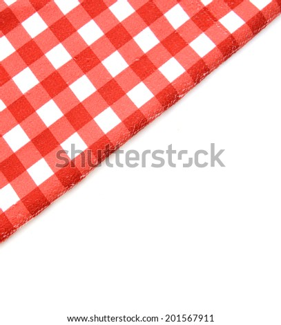 red folded tablecloth over bleached table  - stock photo