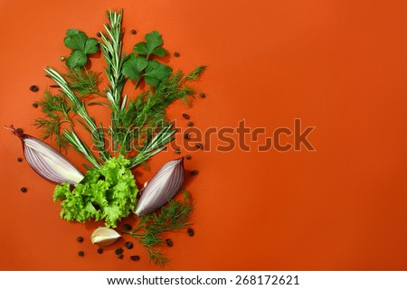 Red food background with fresh aromatic herbs and spices, copy space, top view - stock photo