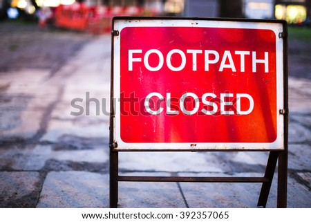 Red Footpath Closed Sign Warning on Road - stock photo