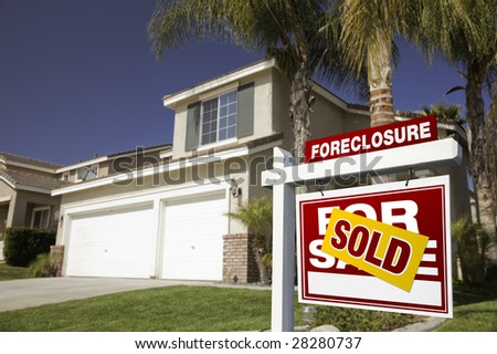 Red Foreclosure For Sale Real Estate Sign in Front of House. - stock photo