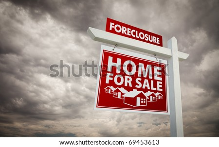 Red Foreclosure Home For Sale Real Estate Sign Over Ominous Cloudy Sky. - stock photo