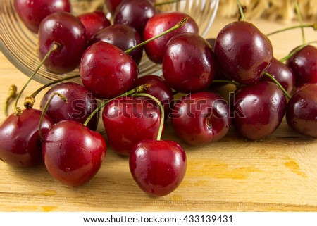Red fresh cherries on the wooden background