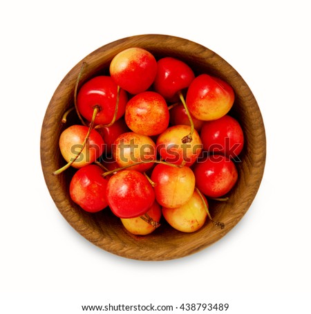 Red fresh cherry fruits in a wooden bowl. Top view. Ripe and tasty cherry isolated on white background. - stock photo