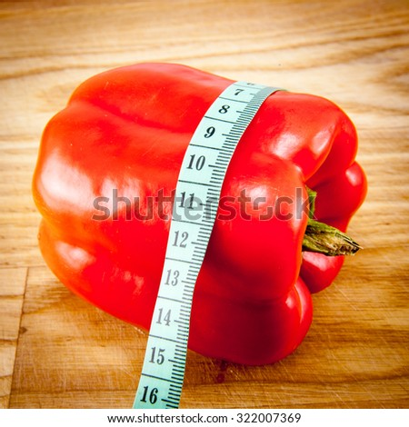 red fresh peppers on cutting board, close-up - stock photo