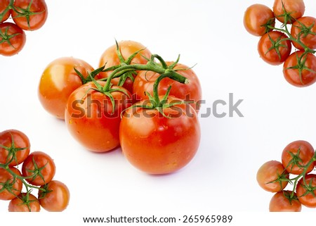 Red Fresh Ripe Stem Tomatoes and Four Corners Tomato Frame Isolated on White Fabric Background - stock photo