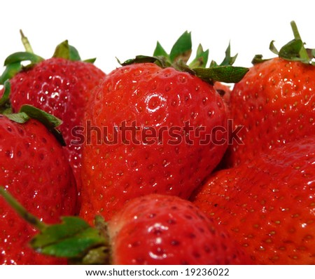 red fresh strawberries close-up on white background - stock photo
