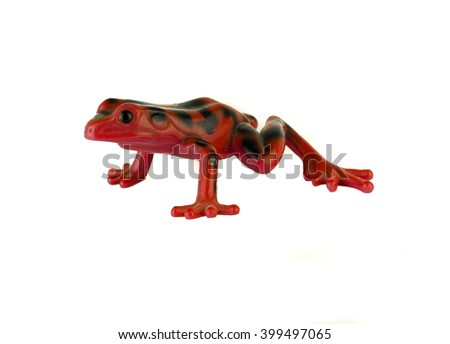 Red frog toy on white background / Green rubber frog toy - bath toy - white background isolated / Platoon green toy frogs. Close up view /  Toy frog - stock photo