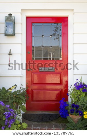 Red front door of an upscale home/Vertical shot of a red front door on