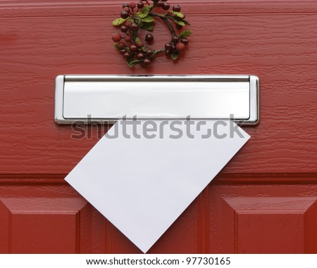 Red front door with mail (post) box and a white letter (envelope). Christmas mail concept. Space for your text. - stock photo