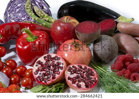 red fruit and vegetables isolated in a group - stock photo