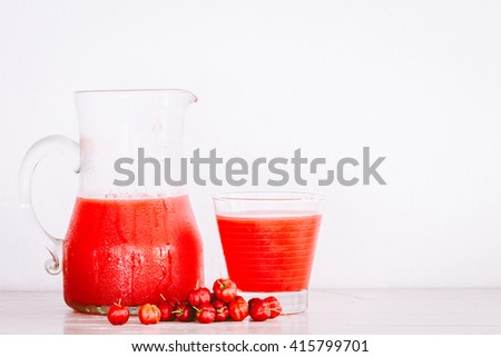 Red fruit drink on wooden table