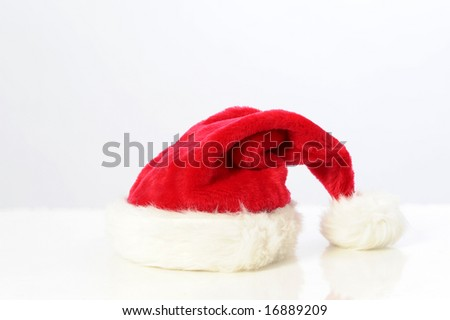 red fur Santa hat for Christmas holiday - stock photo