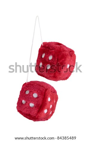 Red fuzzy dice with white dots that are usually hung from the rear view mirror of a car - path included - stock photo